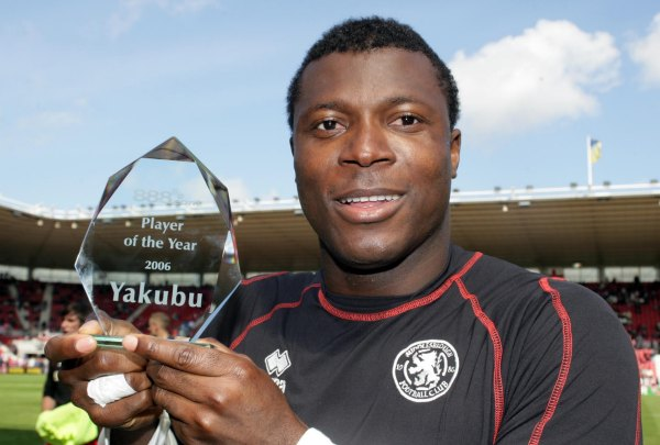 Yakubu with award engraved by Peter Russell Engravers